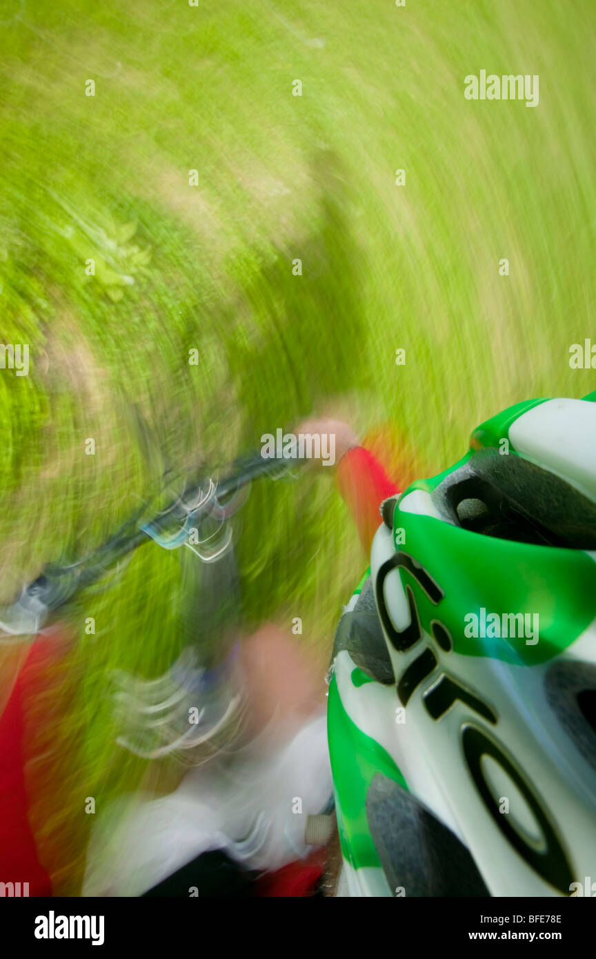 Different perspective and motion highlight the energy of mountain biking, Comox Valley, Vancouver Island British - Stock Image