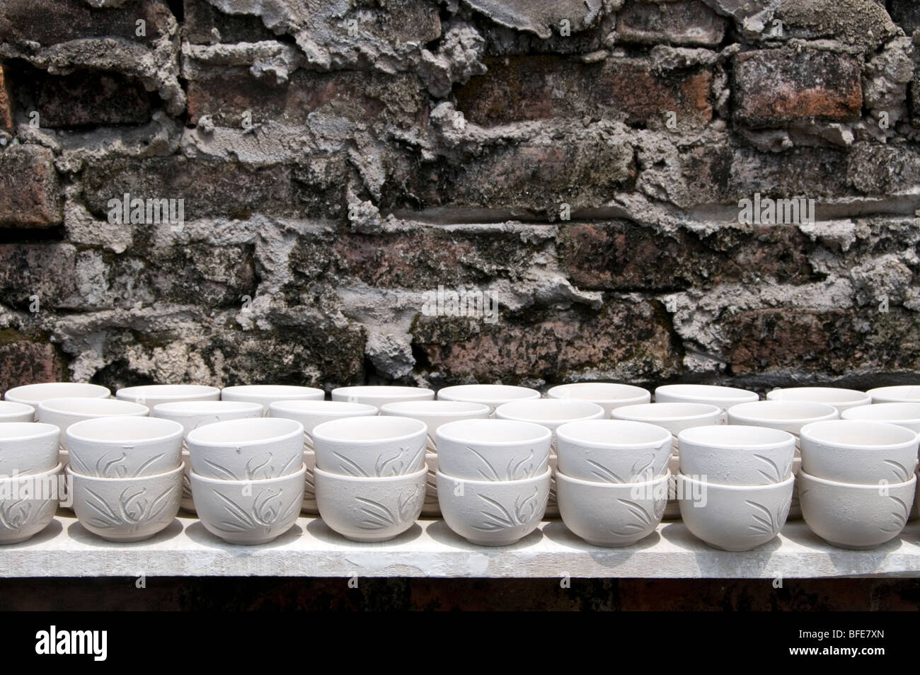 Cups drying in the sun at Bat Trang Commune, Gia Lam District, Hanoi, Vietnam - Stock Image