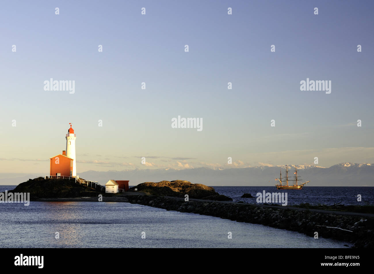 Fisgard Lighthouse and tall ship Bounty at Fort Rodd Hill National Historic Site Victoria Vancouver Island British - Stock Image