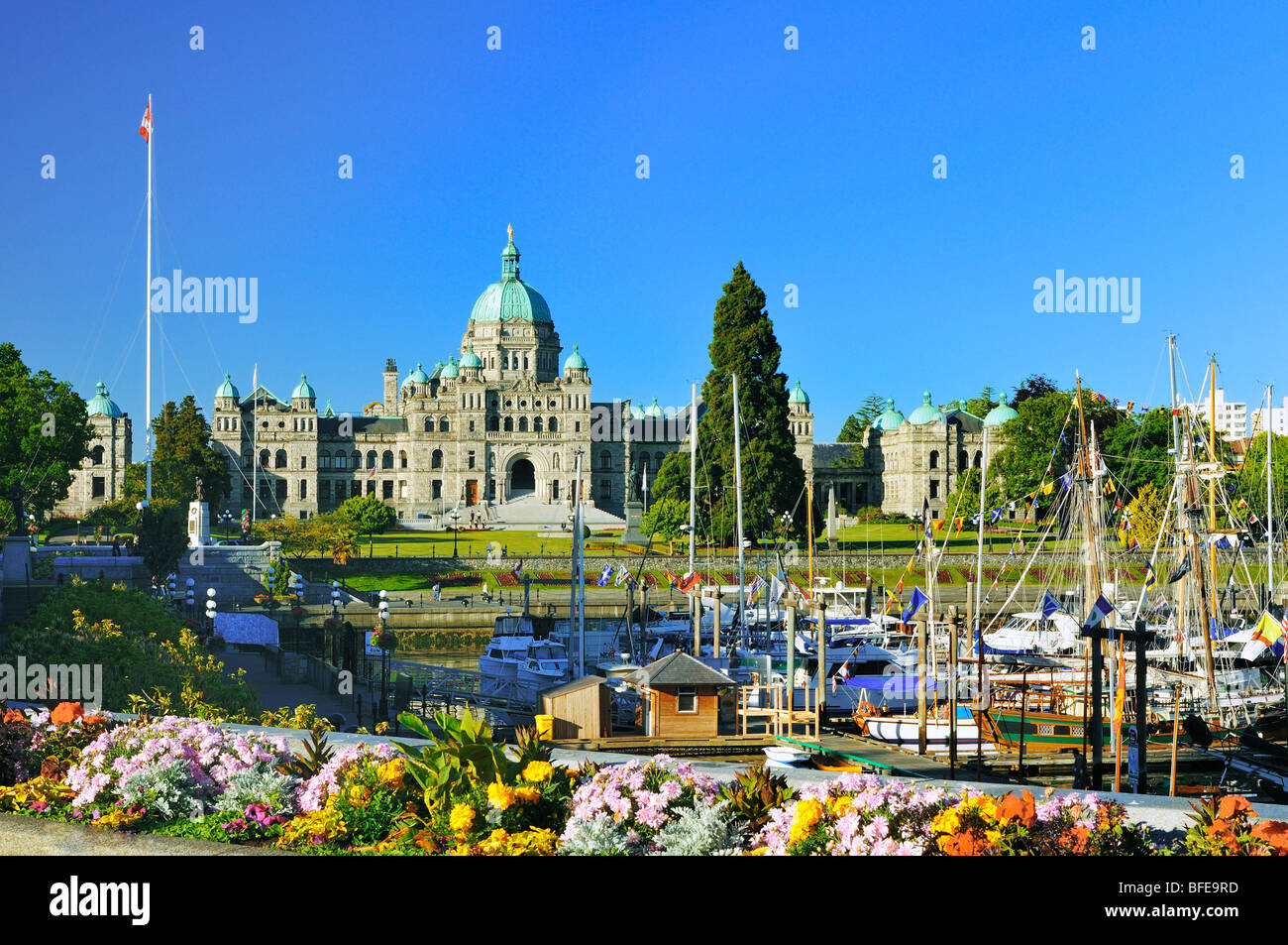 Flowerbed and Inner Harbour with Parliament buildings, Victoria, Vancouver Island, British Columbia, Canada - Stock Image