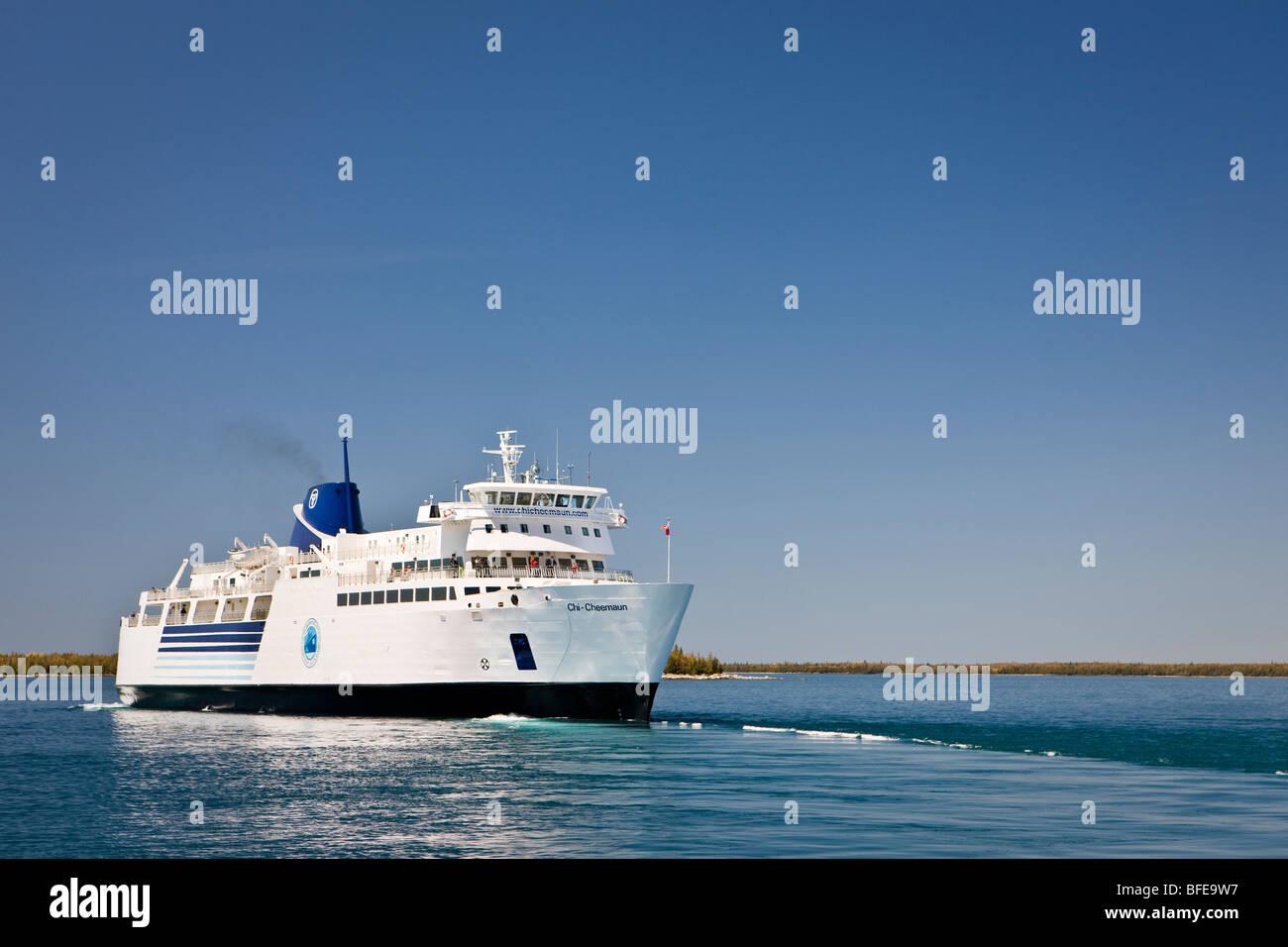 Chi-Cheemaun passenger and vehicle ferry departing Tobermory on Bruce Peninsula for Manitoulin Island on Lake Huron - Stock Image