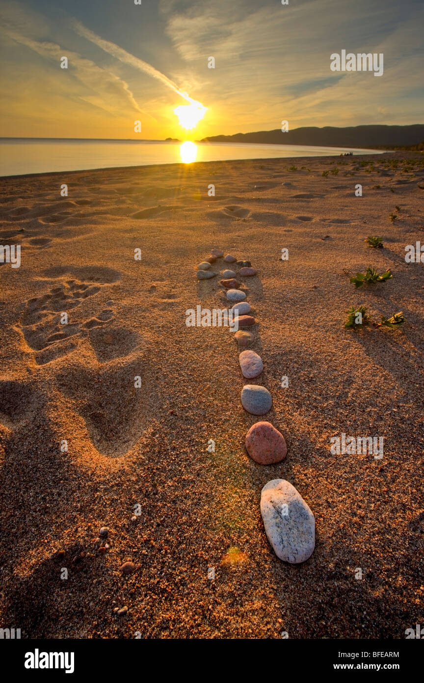Arrow made from rocks along the beach in Agawa Bay at sunset, Lake Superior, Lake Superior Provincial Park, Ontario, - Stock Image