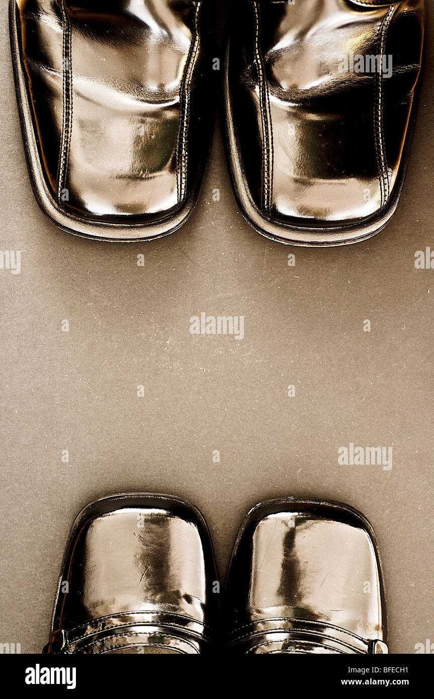 man and woman's shoes facing each other - Stock Image