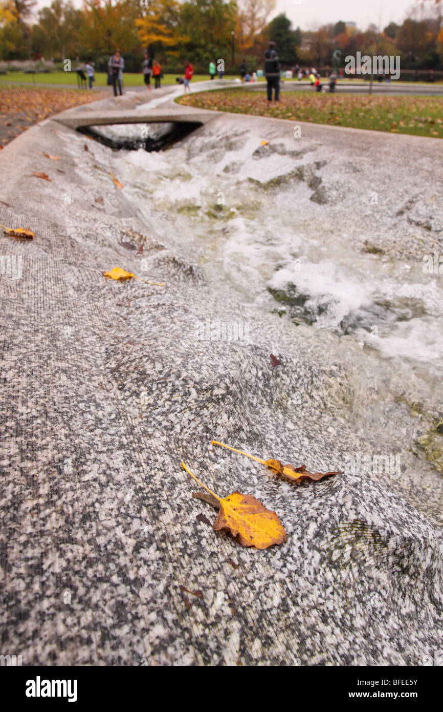 Hyde Park London the Diana Princess of Wales Memorial Fountain made of Cornish Granite stone in autumn - Stock Image