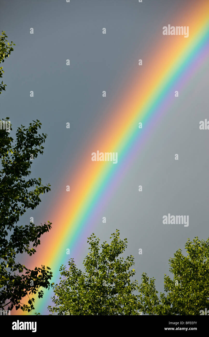 Rainbow forming during a thunderstorm in the city of Regina, Saskatchewan, Canada Stock Photo