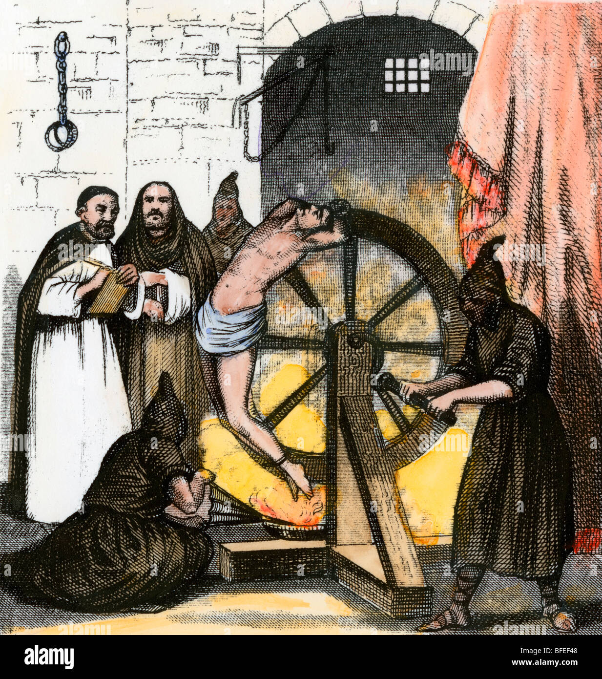 Heretic tortured during the Inquisition. Hand-colored engraving - Stock Image