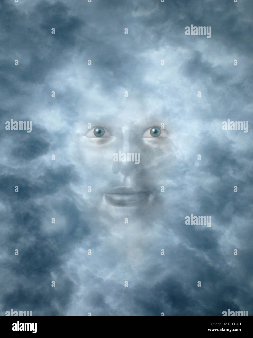 Spiritual face peering through clouds possibly a god or deity - Stock Image