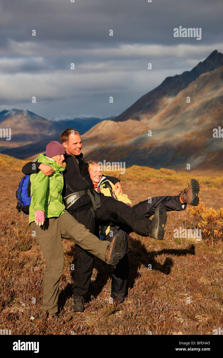 Hikers doing the can-can dance in the tundra of Tombstone Park, Yukon, Canada - Stock Image