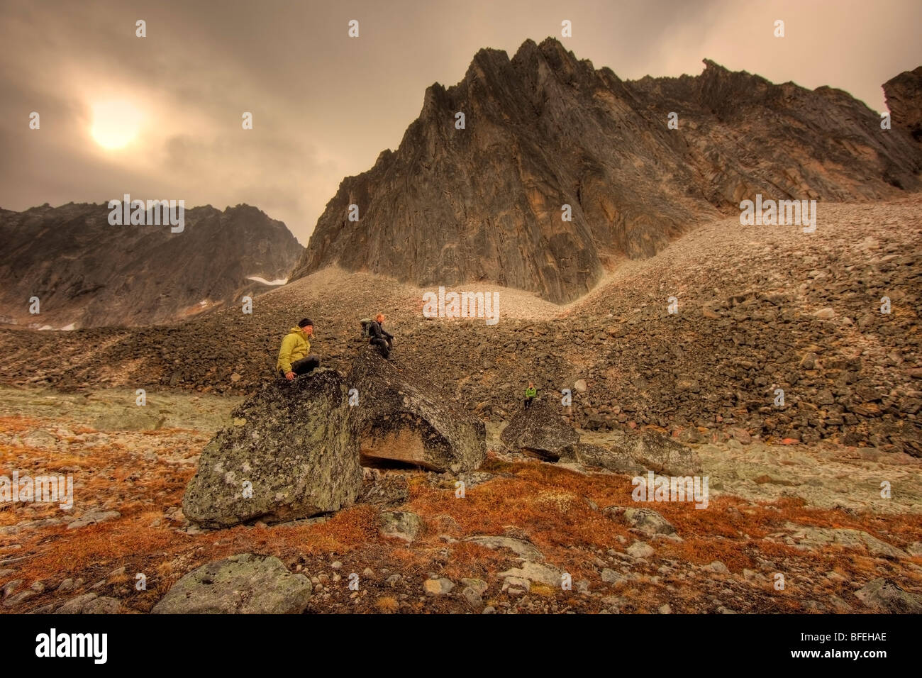 Hikers taking a break from backpacking in Tombstone Territorial Park, Yukon, Canada - Stock Image
