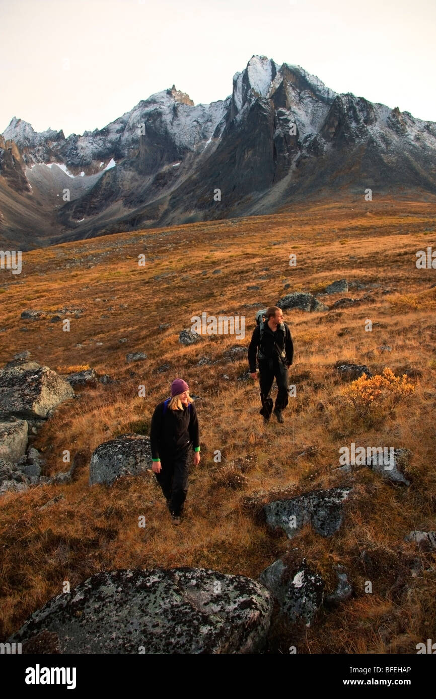 Hikers hiking in Tombstone Territorial Park, Mount Monolith is seen in background, Yukon, Canada - Stock Image