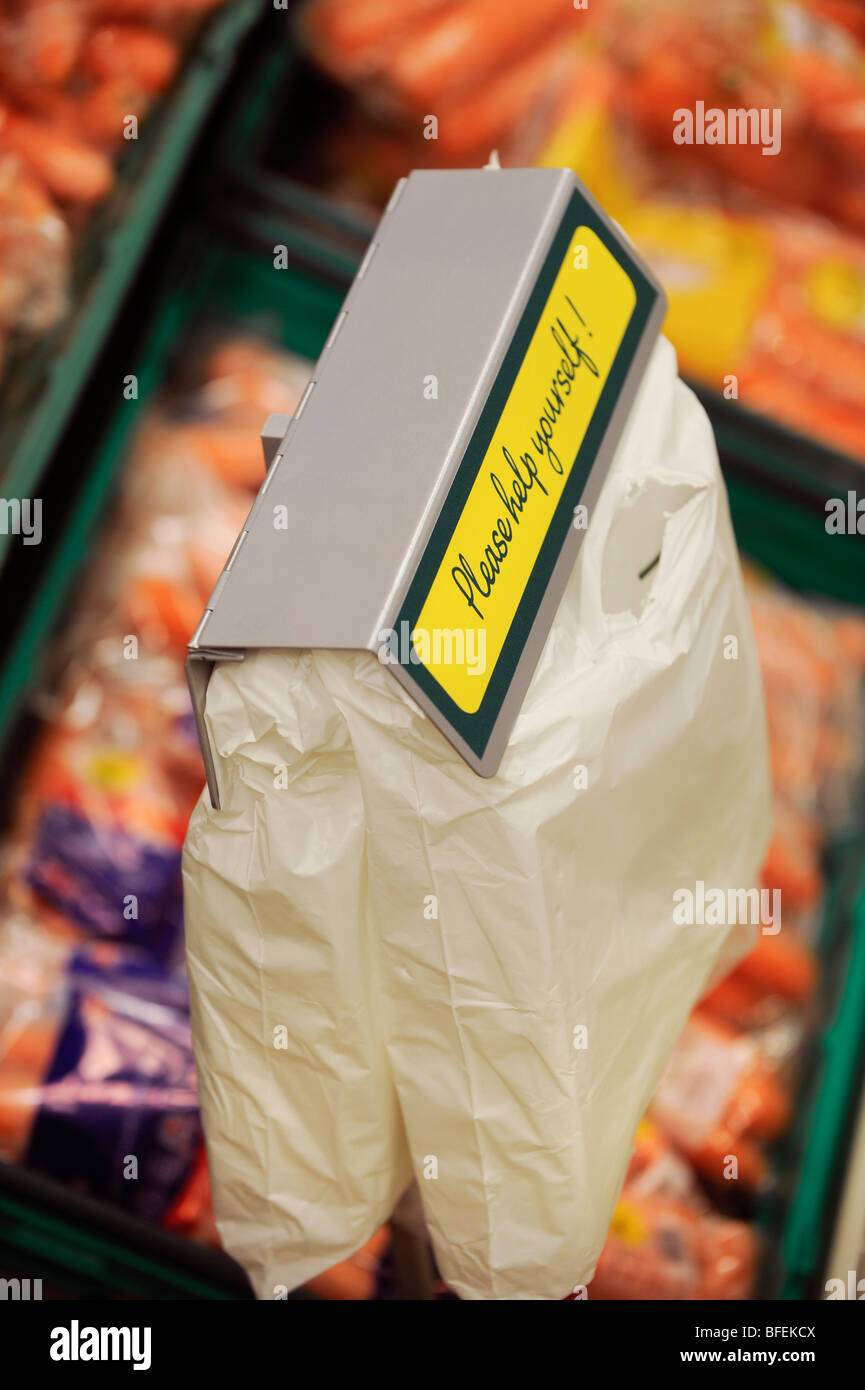 A bag dispenser at the fruit and vegetable aisle in a Morrisons supermarket. Stock Photo