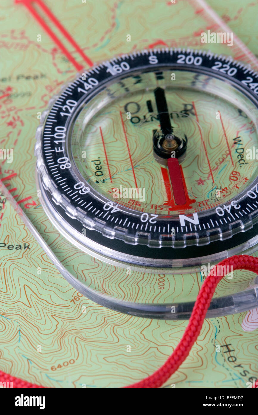 A hiking compass on a Topo map - Stock Image