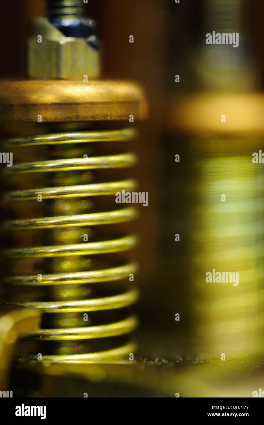 Closeup of the spring mechanism inside a relay switching device - Stock Image