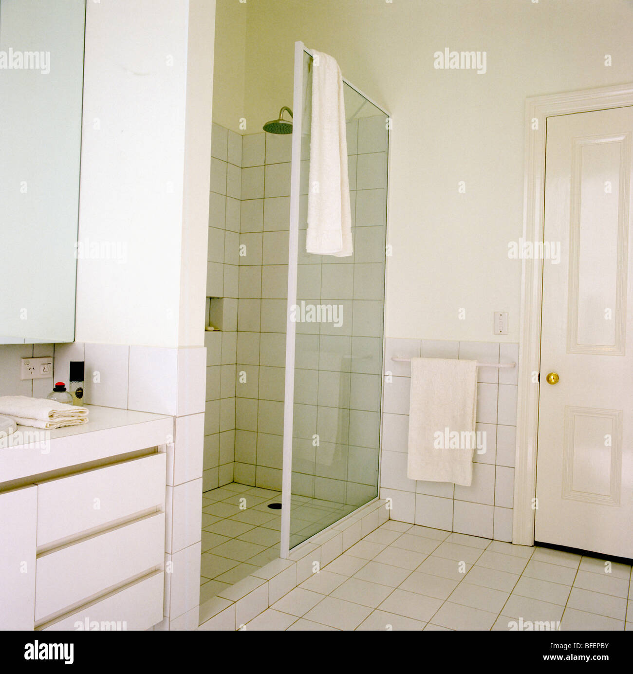 Walk-in shower with glass doors in modern white bathroom Stock Photo ...
