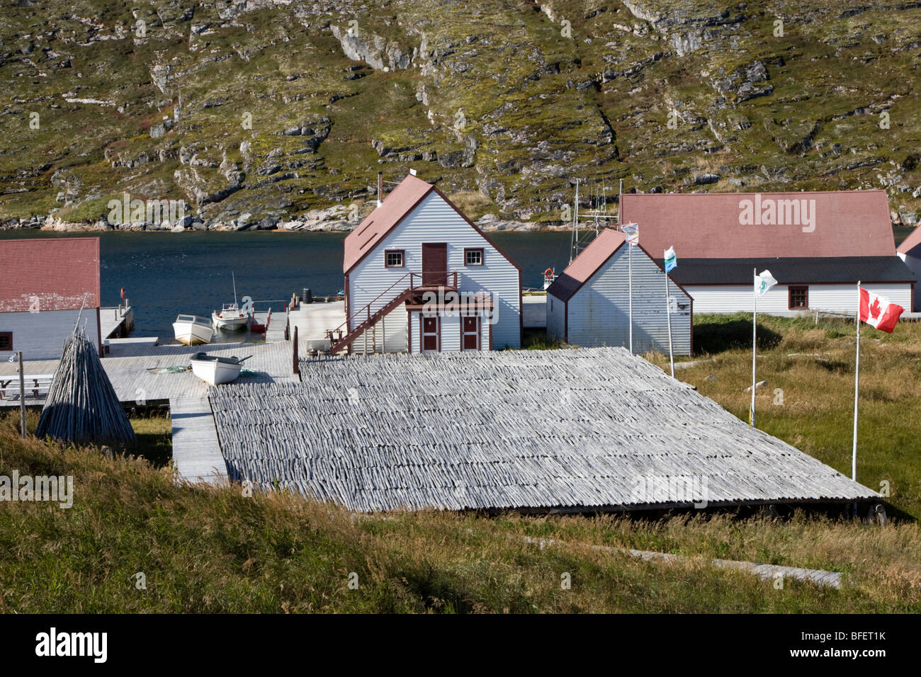 Rebuilt fish drying flake and restored buildings, Battle Harbour, Labrador, Canada - Stock Image