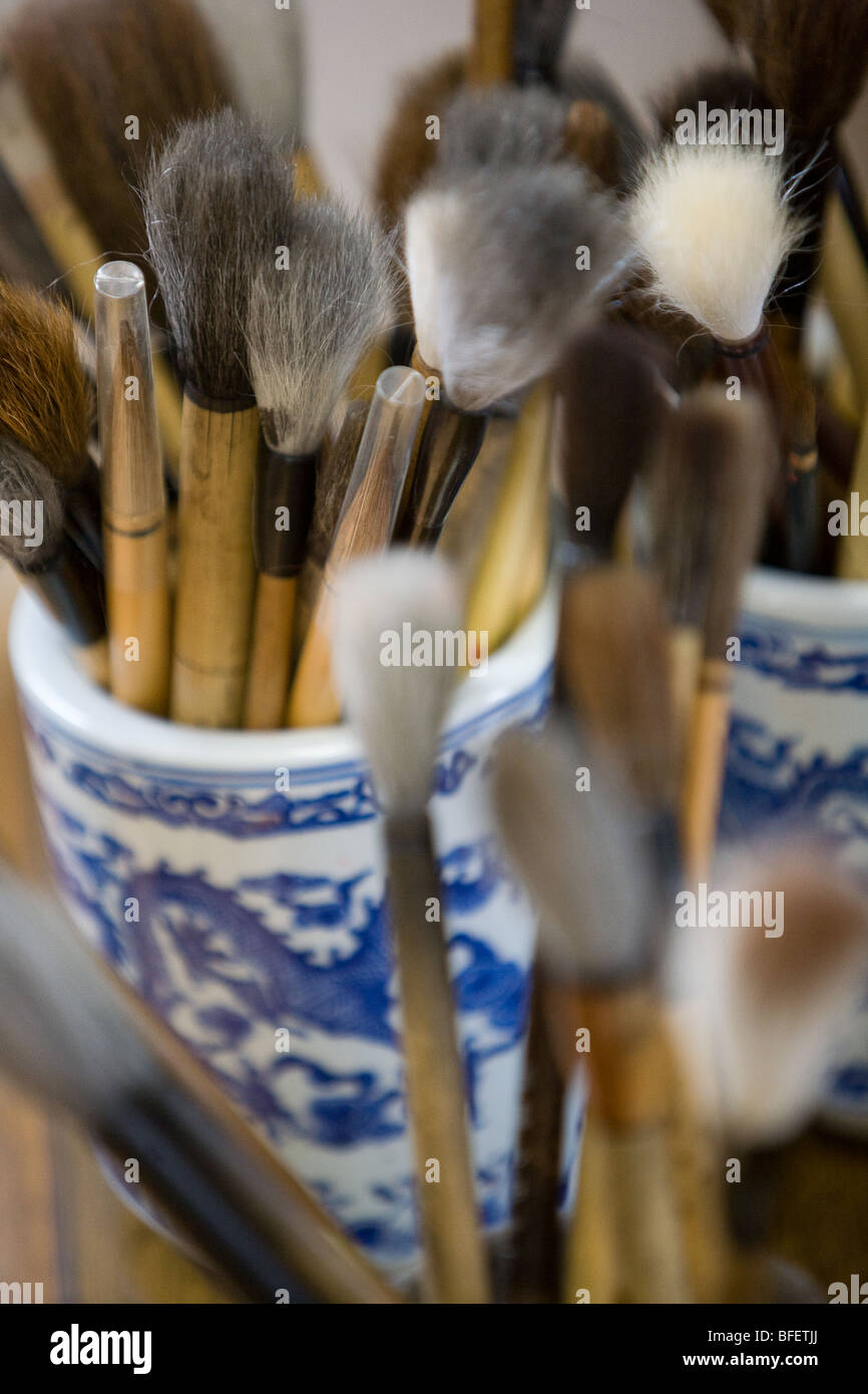 Calligraphy art painting brushes in a jar. - Stock Image