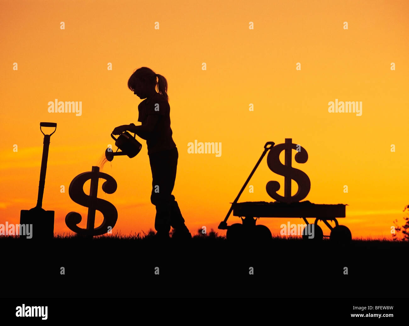 Conceptual of a young girl watering a newly planted dollar sign near Winnipeg, Manitoba, Canada Stock Photo