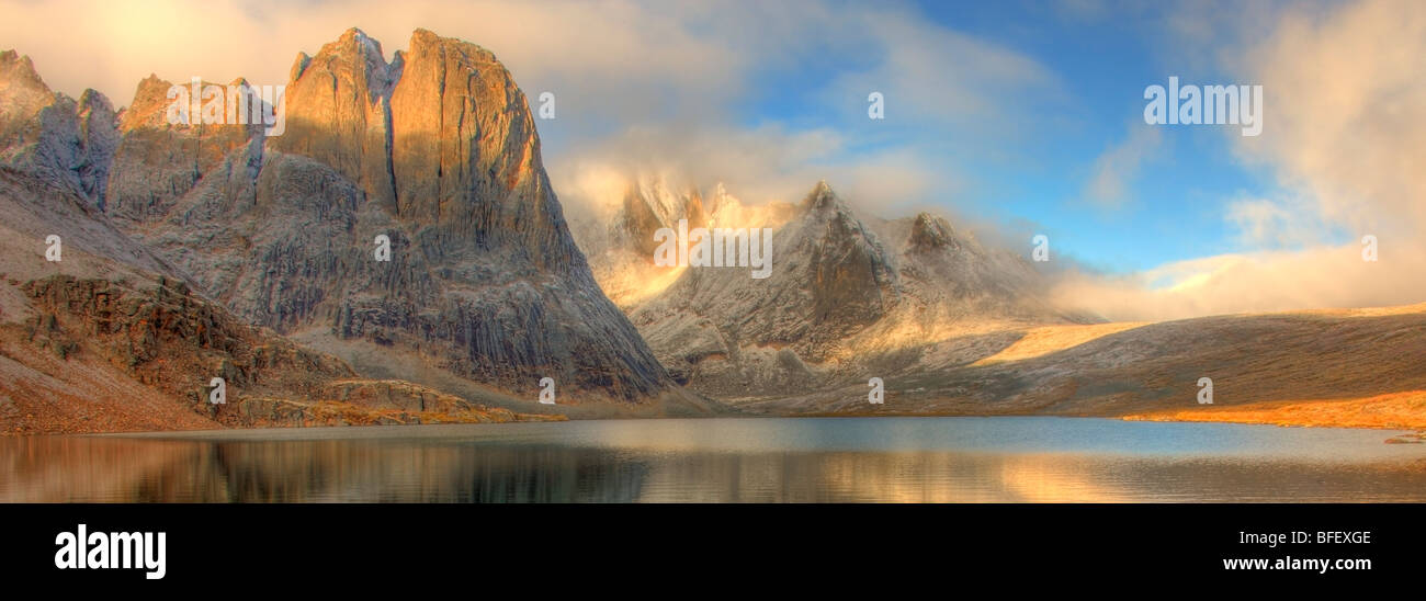 Divide Lake at sunrise with Mount Monolith towering above it. Tombstone Territorial Park, Yukon. - Stock Image
