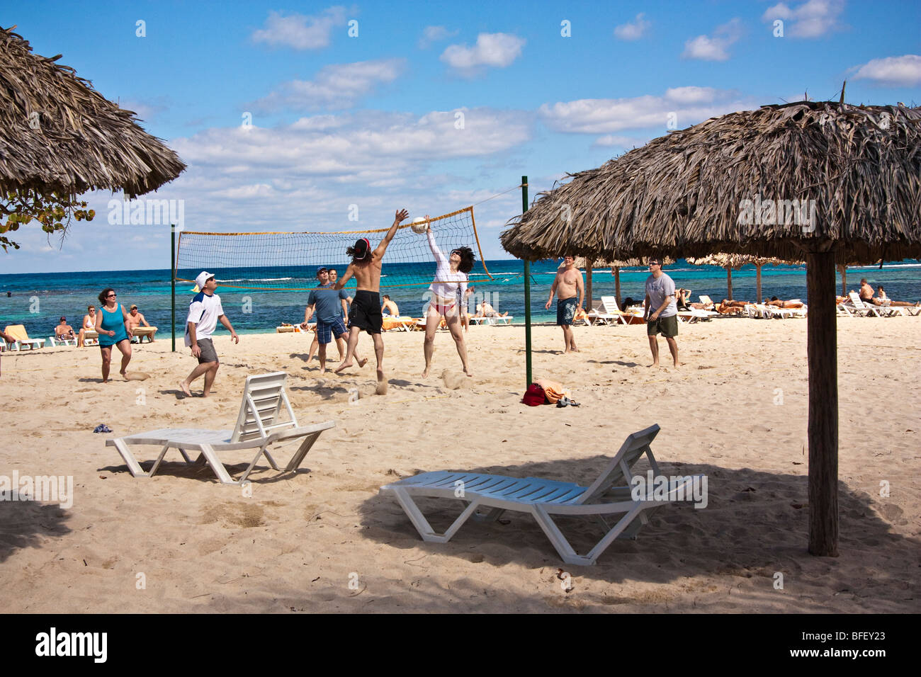 People playing beach volleyball, Caribbean, Cuban resort - Stock Image