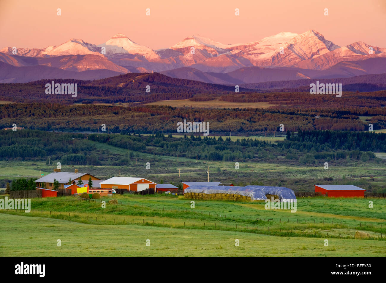 foothills Ranch in early morning light, Cochrane, Alberta, Canada, agriculture, mountains, rockies - Stock Image