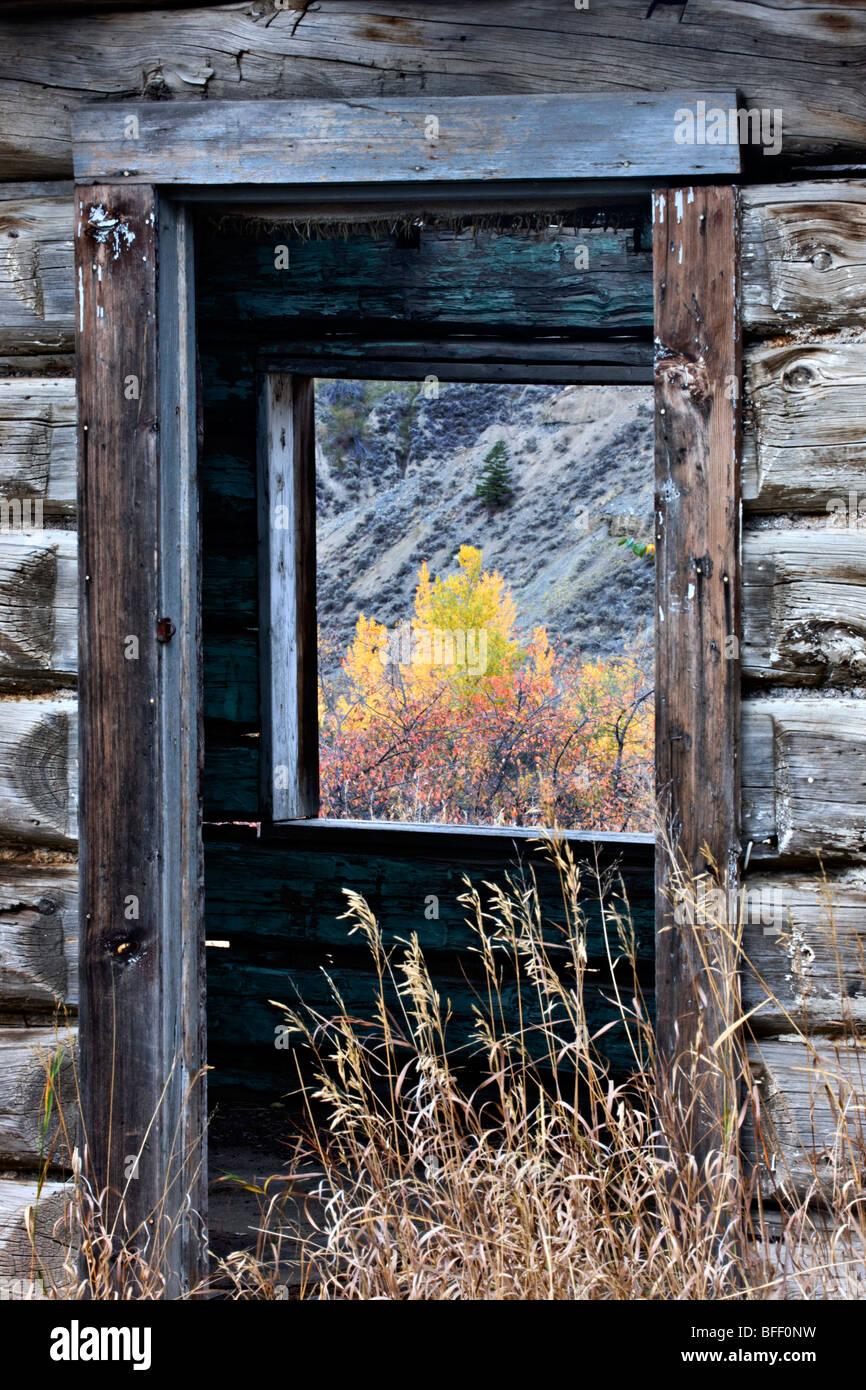 Abandoned log ranch house at Farwell Canyon British Columbia Canada - Stock Image