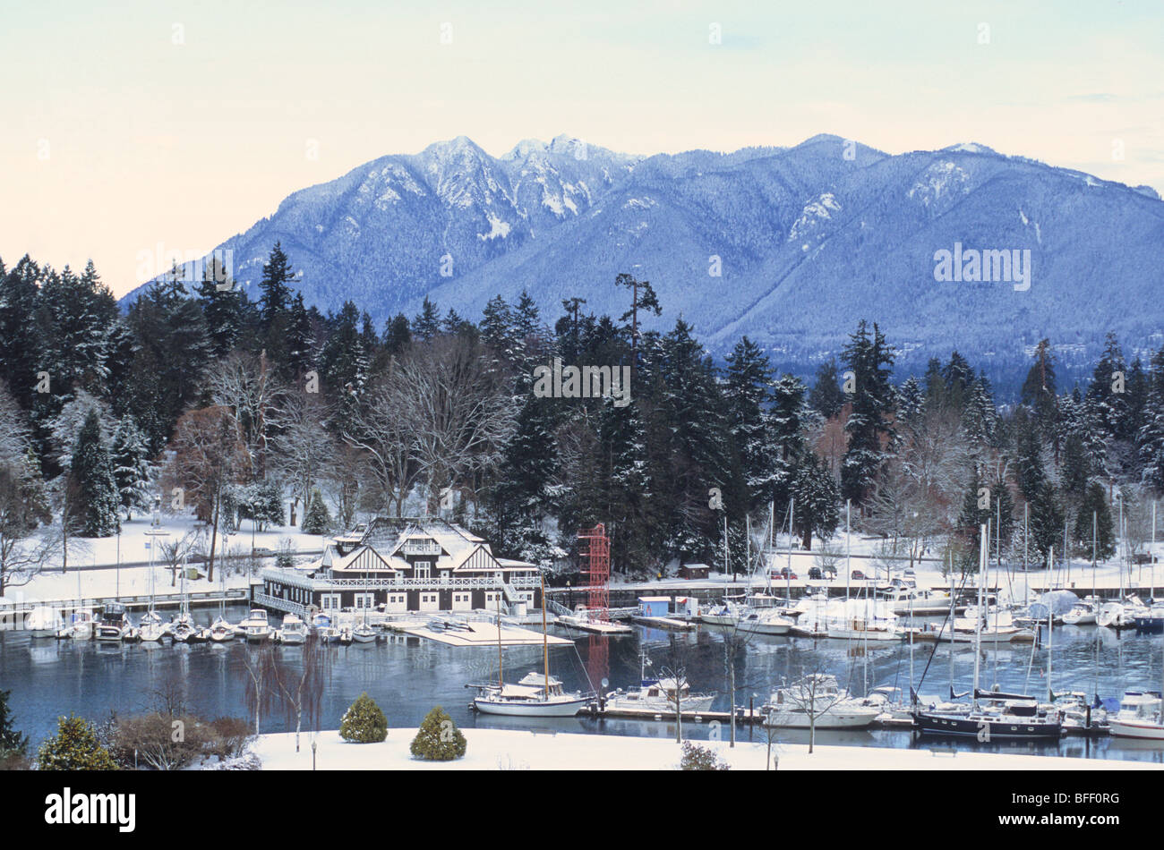 Vancouver Rowing Club, Stanley Park, and North Shore Mountains in snow, Vancouver, British Columbia, Canada - Stock Image