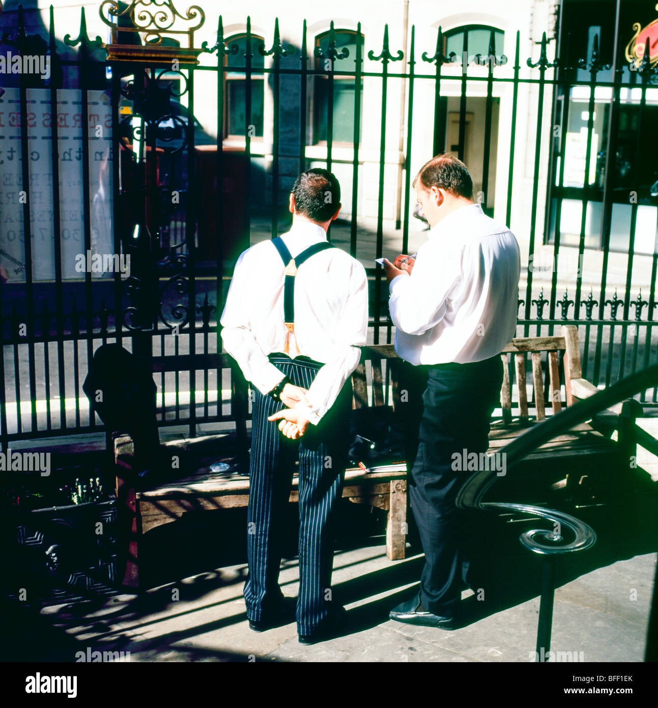 A back view of two businessmen in the City of London outside St Mary Wolnoth Church in the summer of 2009 - Stock Image