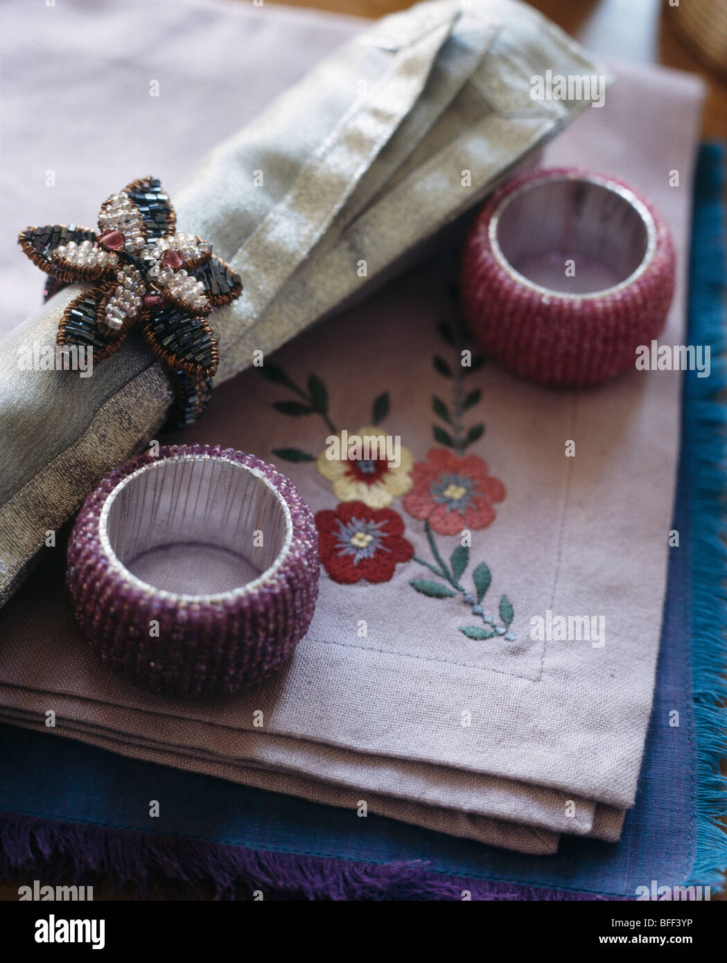 Close Up Of Embroidered Linen Table Napkins With Beaded Napkin Rings Stock Photo Alamy