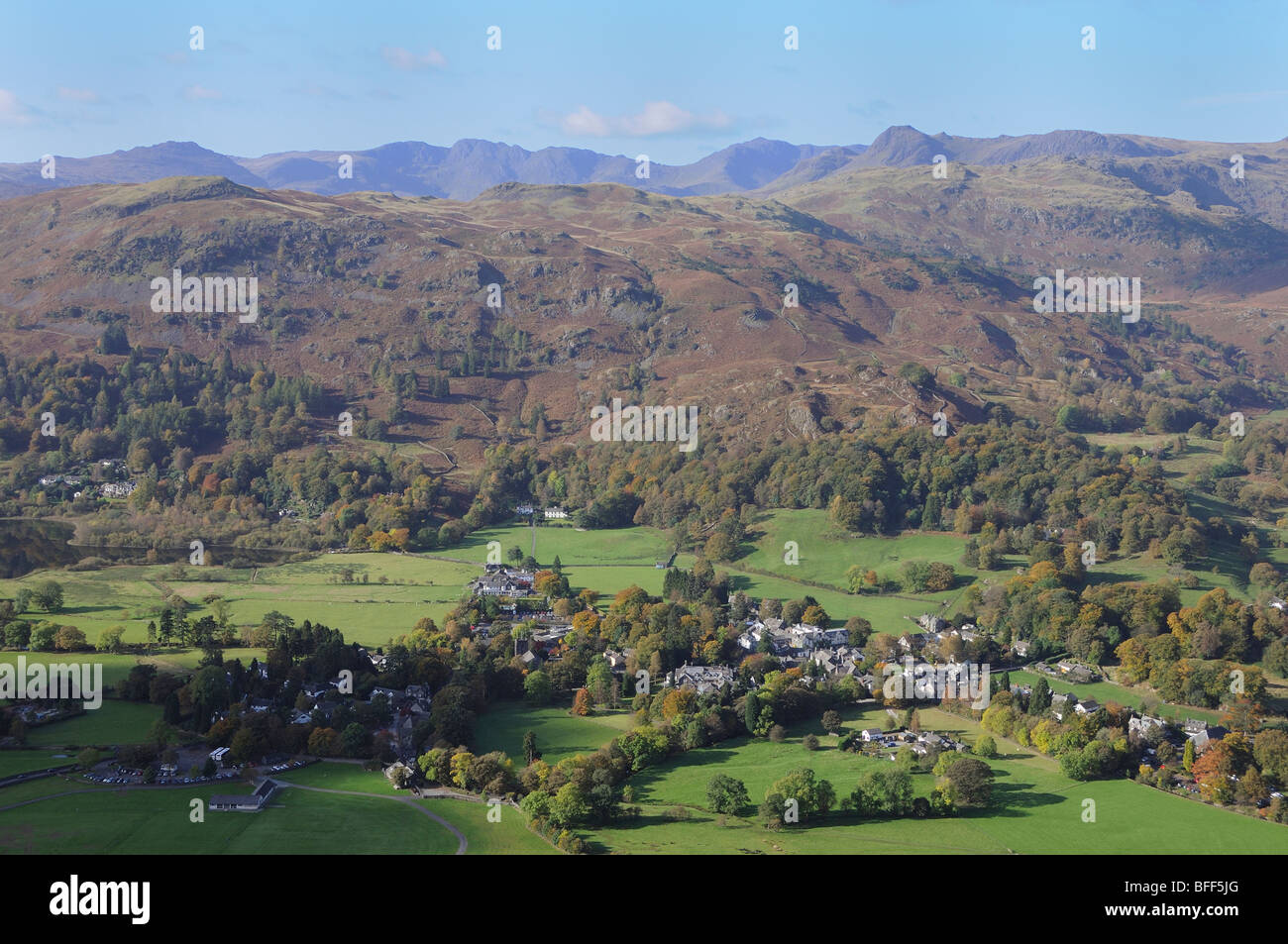 The little village of Grasmere sits in the valley below the slopes of Silver How in the English Lake District - Stock Image