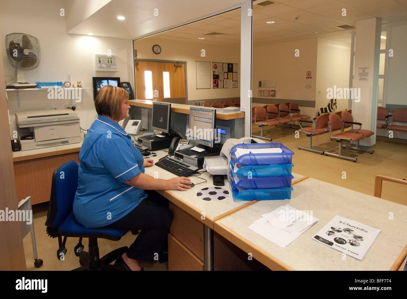 hospital receptionist at the dr johnson hospital lichfield staffordshire stock image