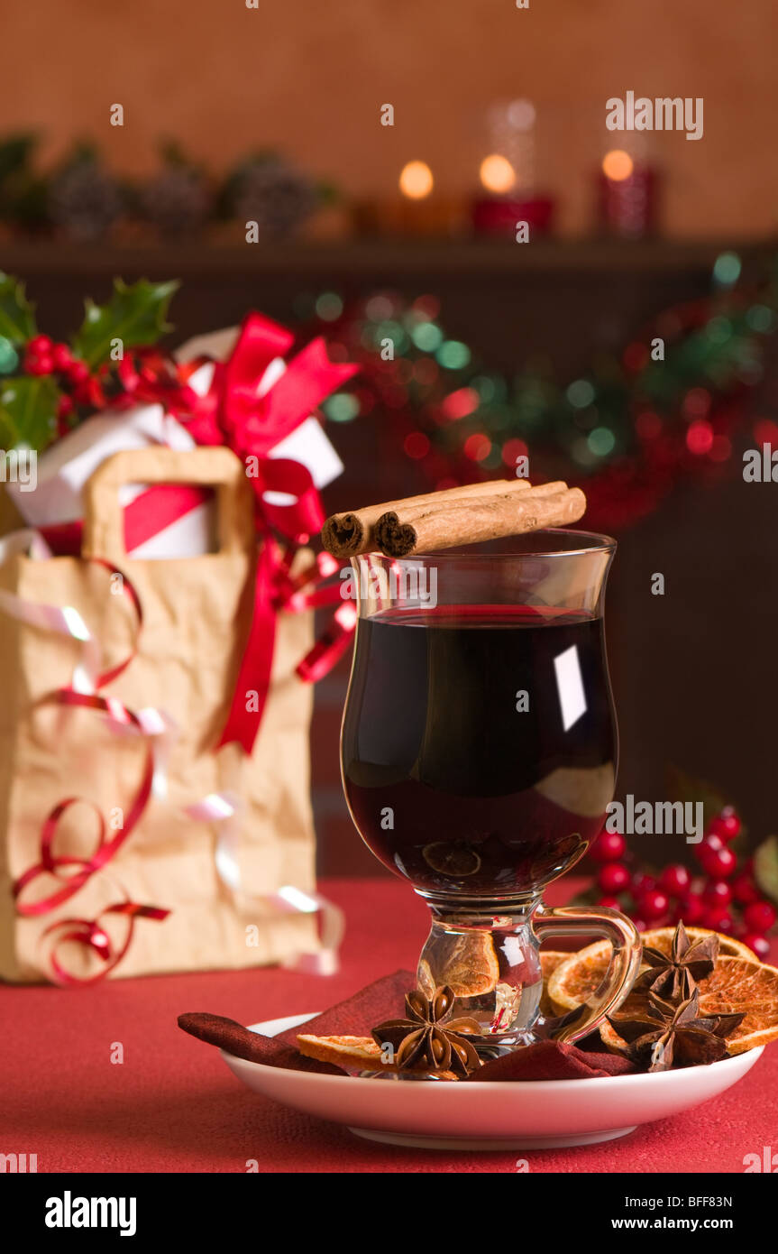 Christmas mulled wine with gift bag with presents in background ...