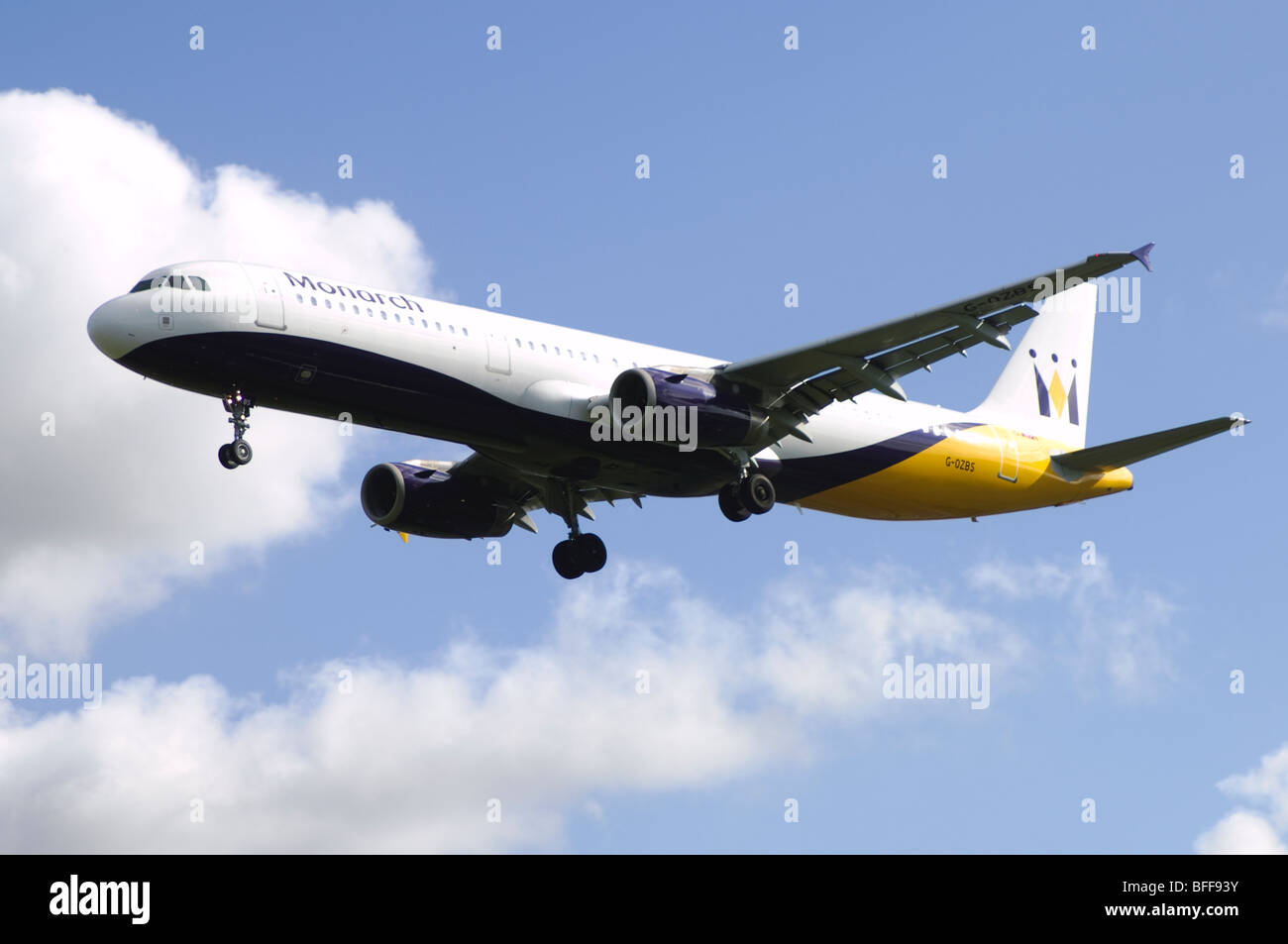 Airbus A3231 operated by Monarch Airlines on approach for landing at Birmingham Airport Stock Photo