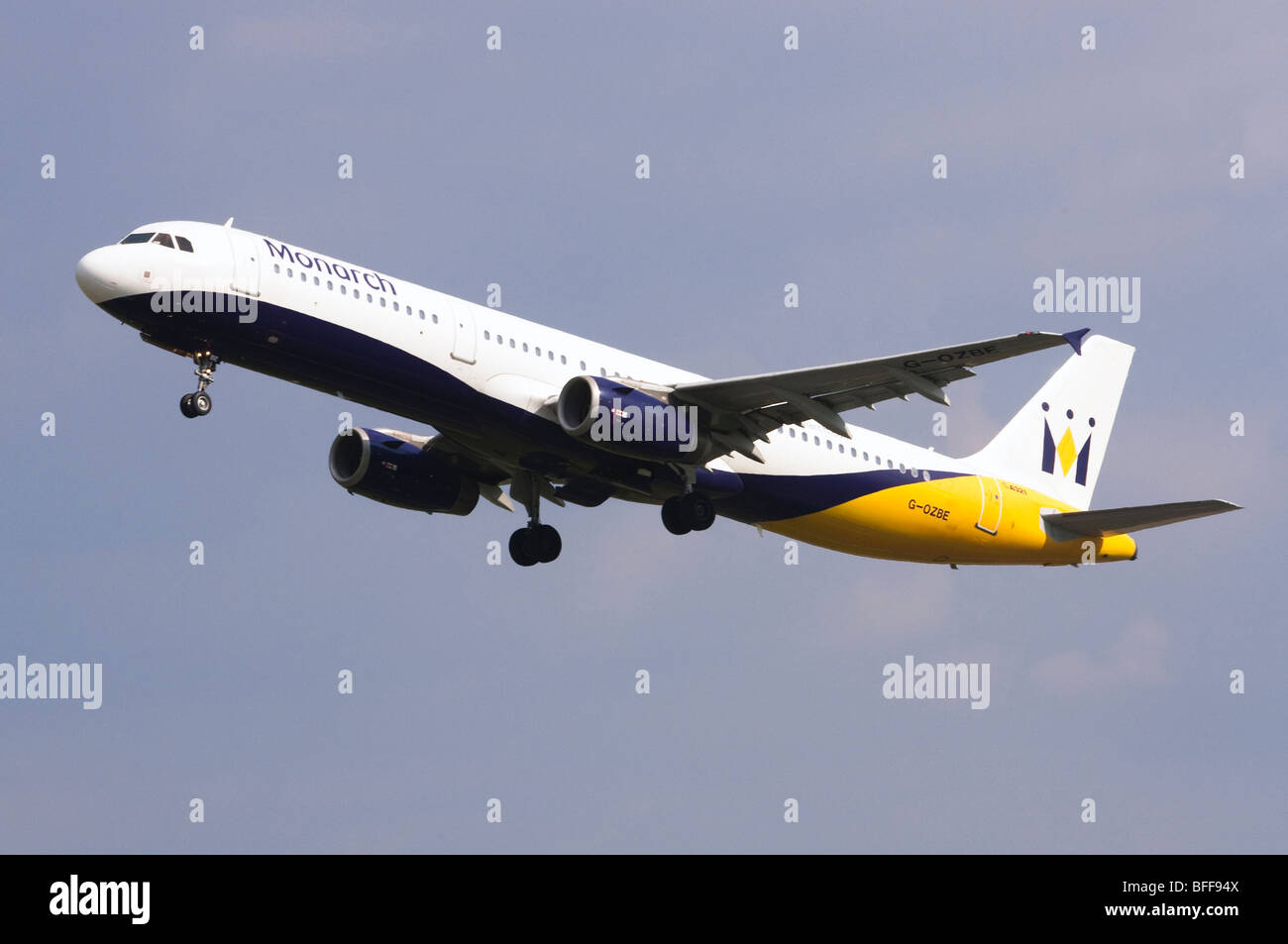 Airbus A3231 operated by Monarch Airlines taking off from Birmingham Airport Stock Photo