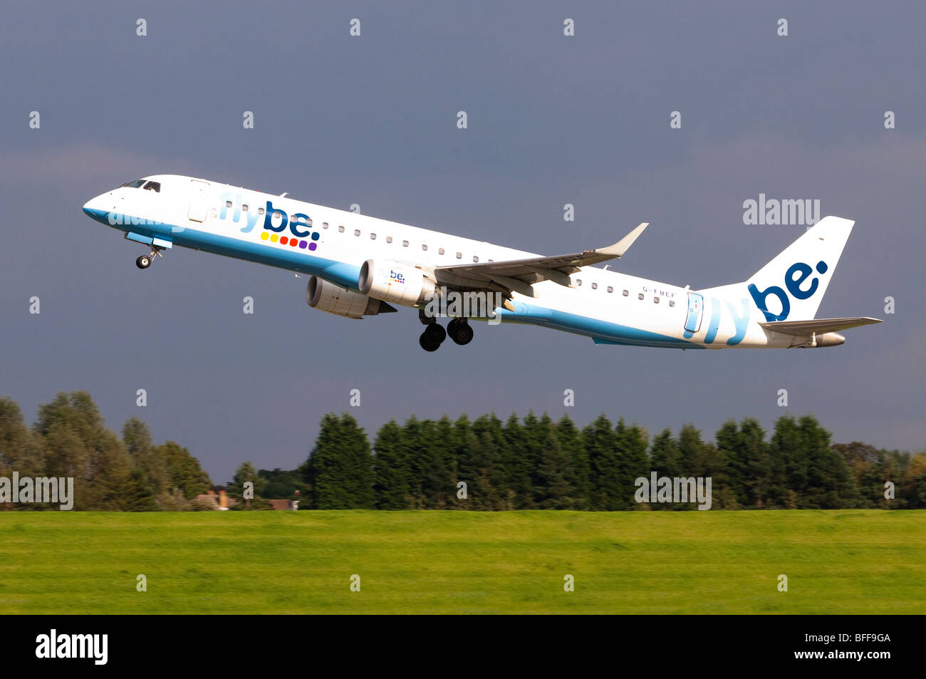 Embraer ERJ-190 operated by Flybe taking off at Birmingham Airport - Stock Image