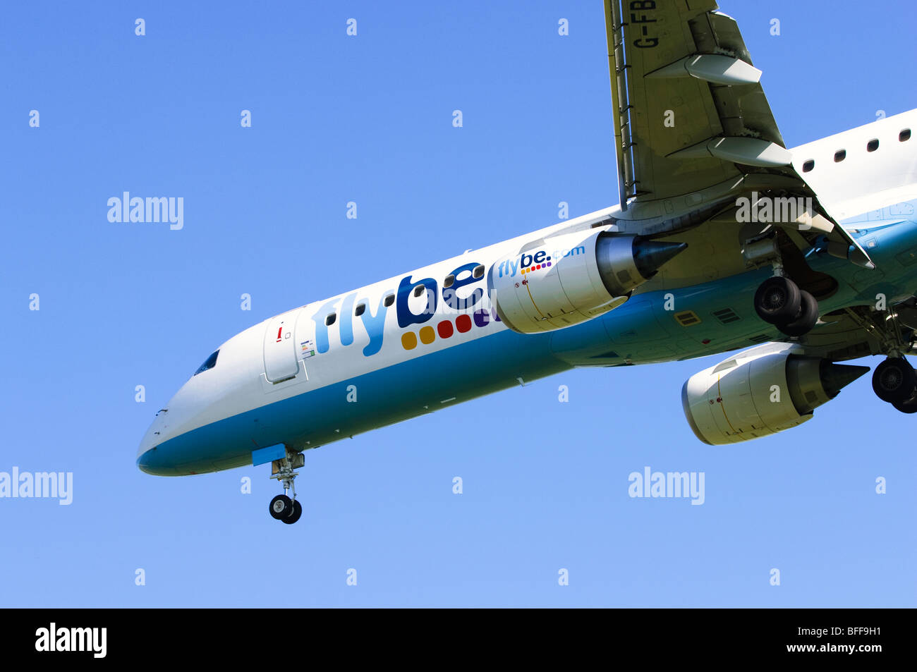 Embraer ERJ-190 operated by Flybe on approach for landing at Birmingham Airport - Stock Image