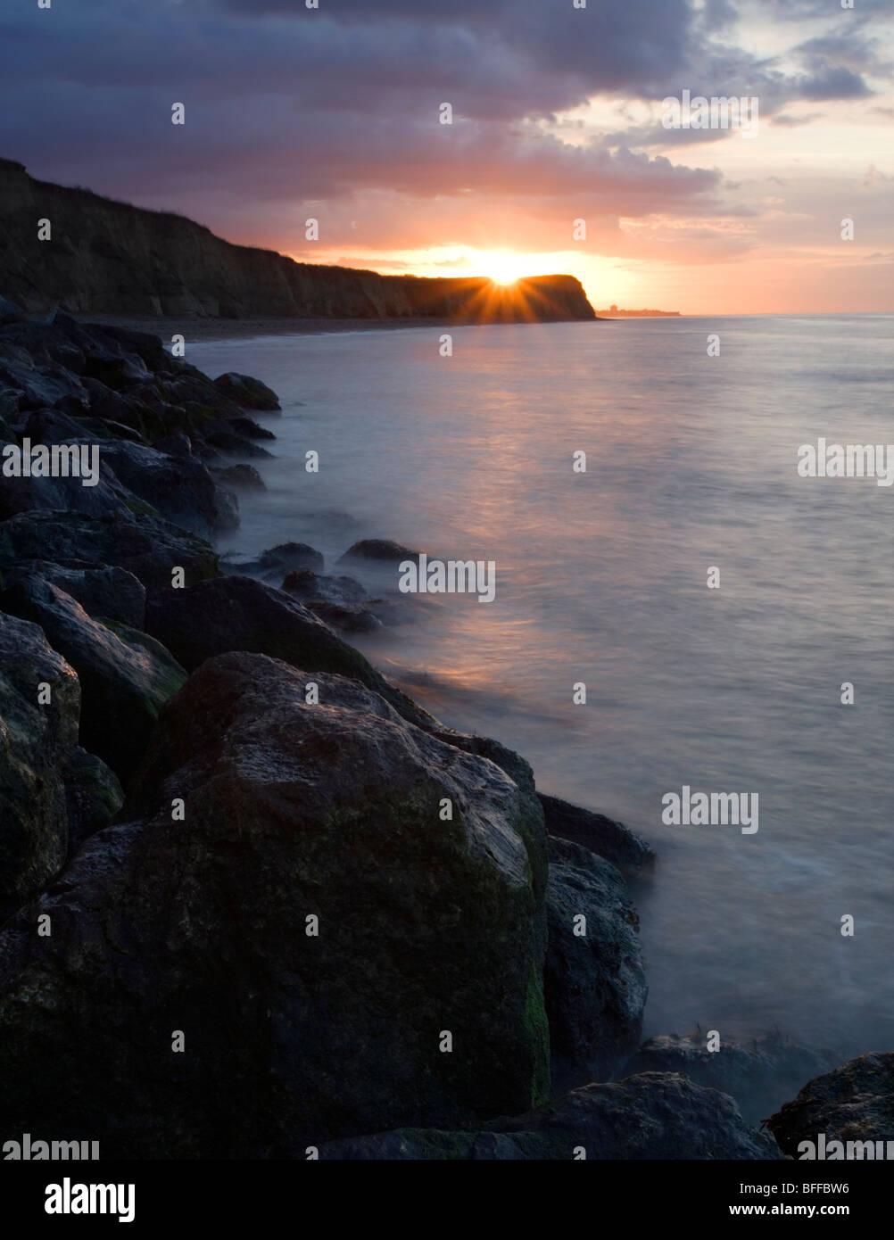 Sunset at Reculver beach in Kent, UK. Stock Photo