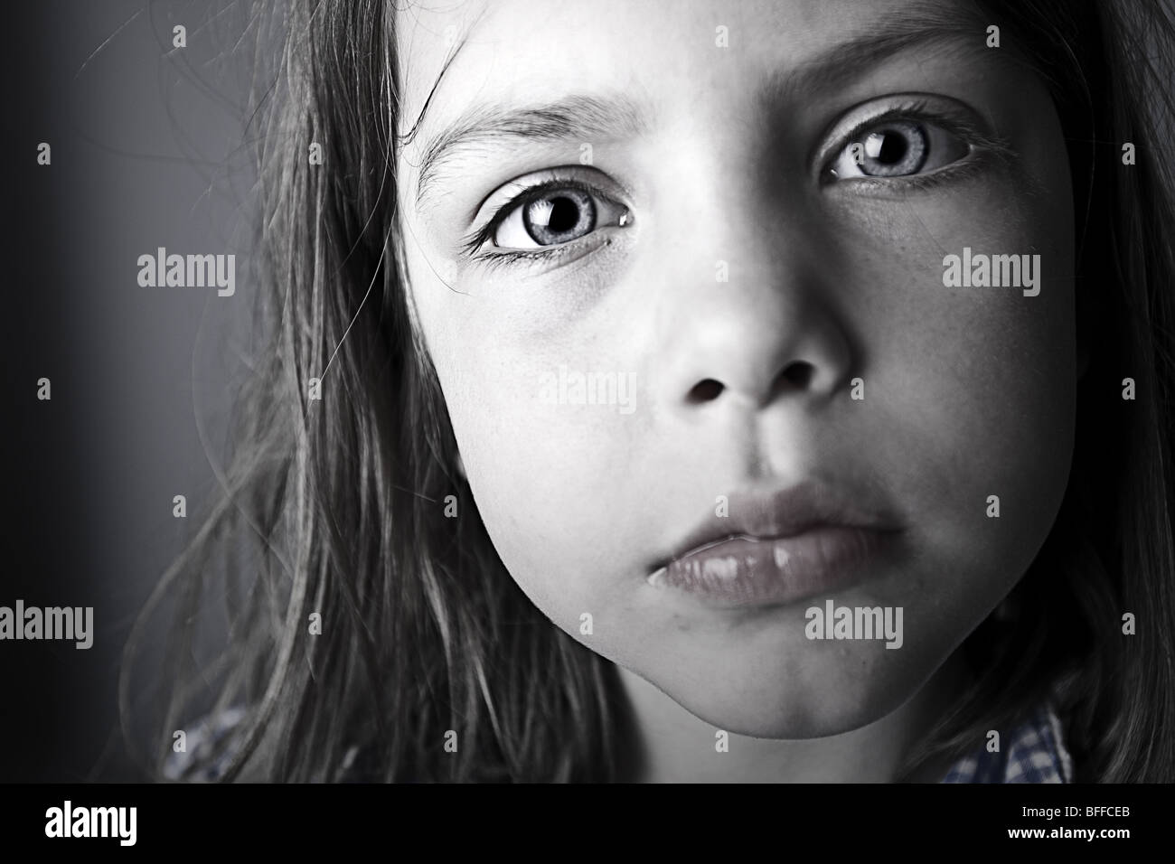 Close Up Shot of an Intense Child - Stock Image