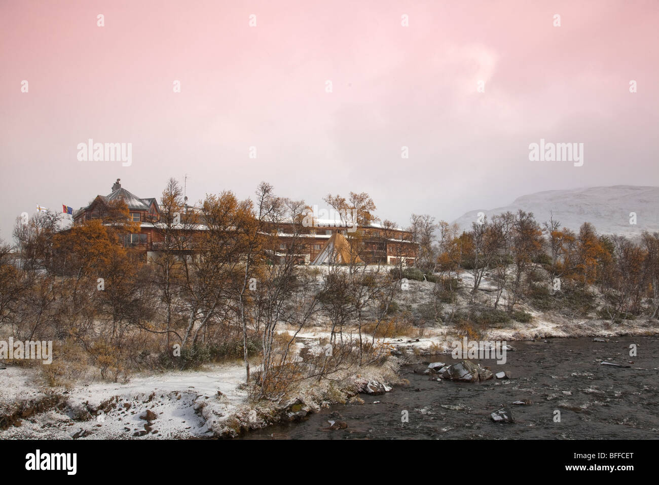 brook Storulvån fjellstation and birch forest in autumn with first snow and view over snowy forest - Stock Image