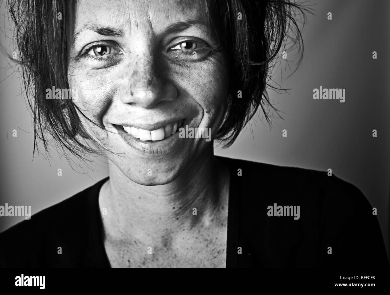 Black and White Shot of a Happy Homeless Person - Stock Image