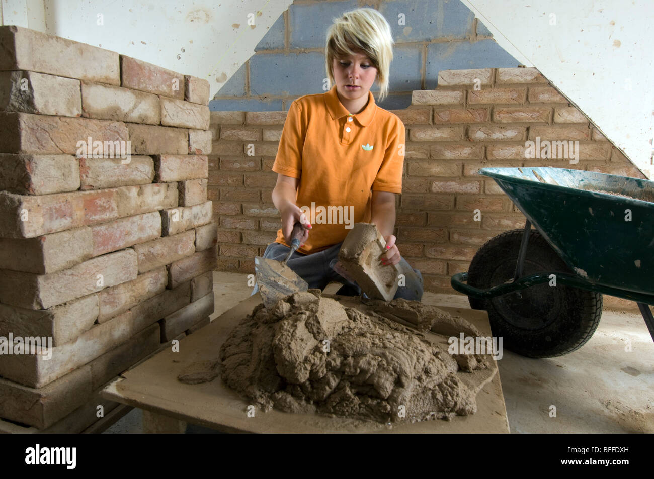 Girl student learning practical bricklaying  at 'City College Brighton' - Stock Image