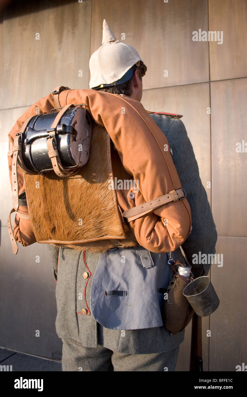 Rear view of soldier wearing WW I German military uniform, with mess kit and sleeping bag. - Stock Image