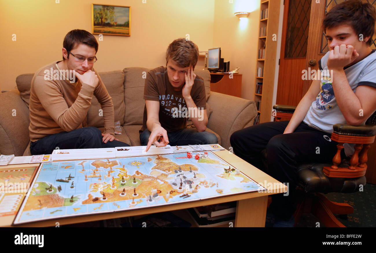 united kingdom two boys playing a board game - Stock Image