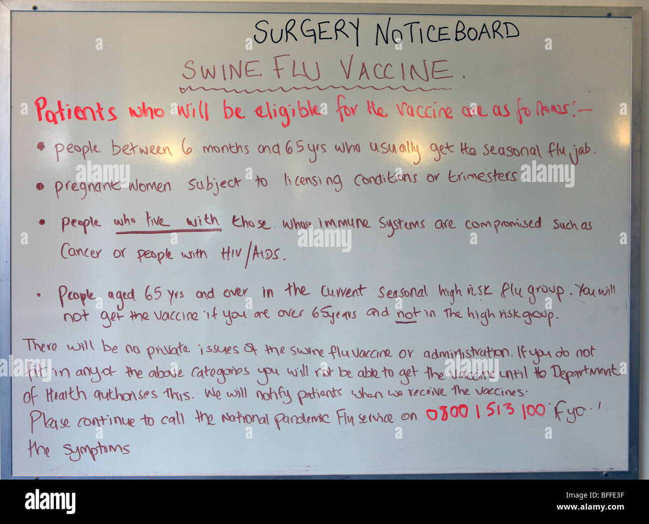 united kingdom doctors surgery noticeboard about swine flu - Stock Image