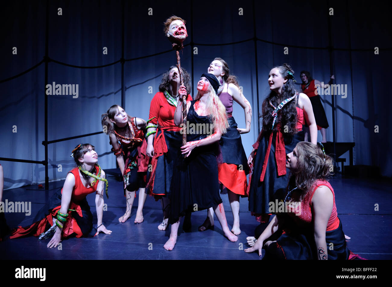 Teenage girls in Mid Powys Youth Theatre performing Greek tragedy The Bacchae by Euripedes at Wyeside Arts Centrel Stock Photo