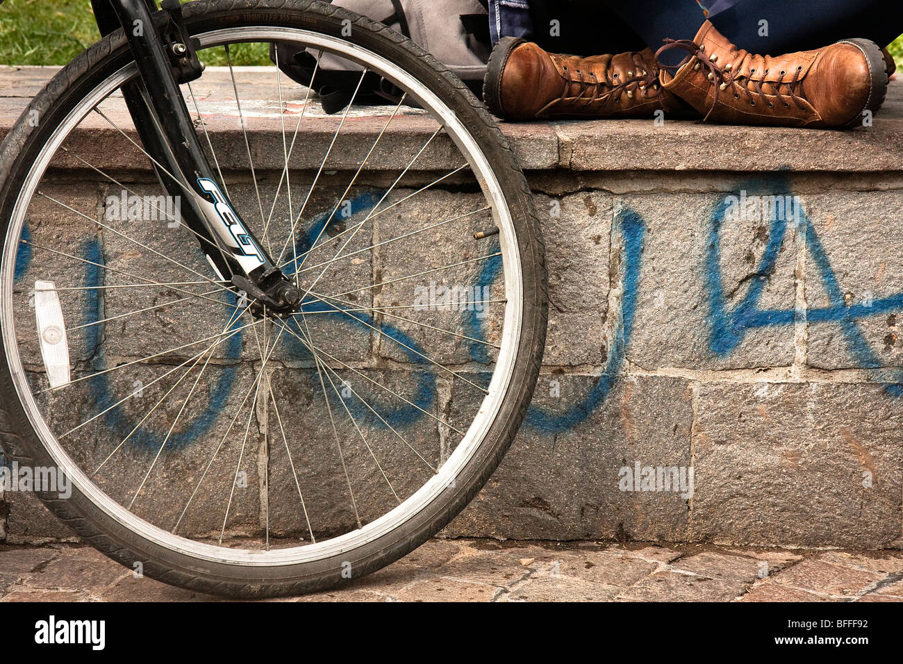 Participant in Critical Mass in Buenos aires sitting with their bicycle - Stock Image