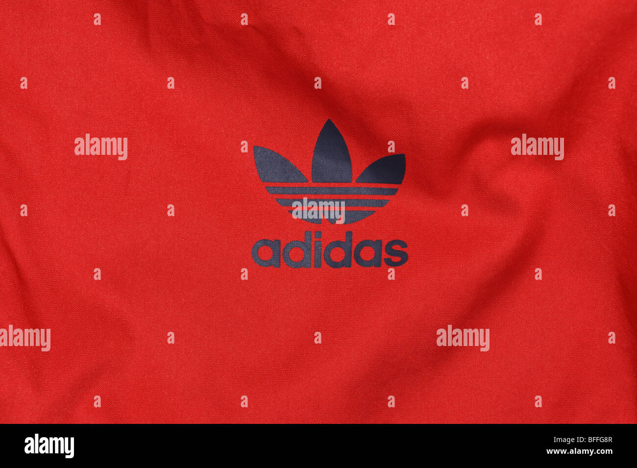 Adidas Trefoil logo on a Paris' windrunner jacket. 'Paris' was arange of tri-coloured jackets from Adidas - Stock Image