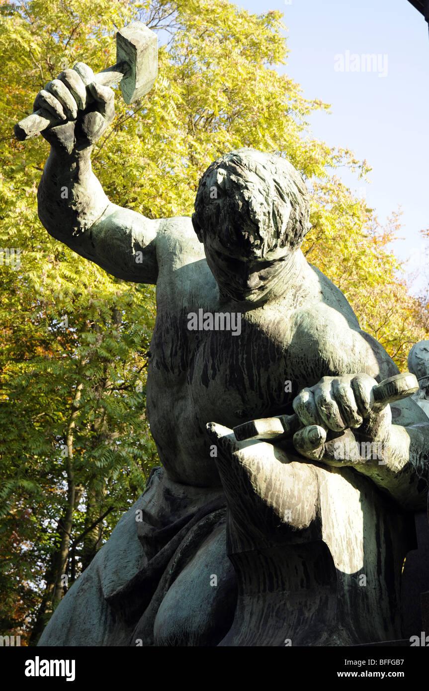 The Bismarck Memorial, Tiergarten, Berlin. Below Bismarck is Siegfried, forging a sword to show Germany's  industrial - Stock Image