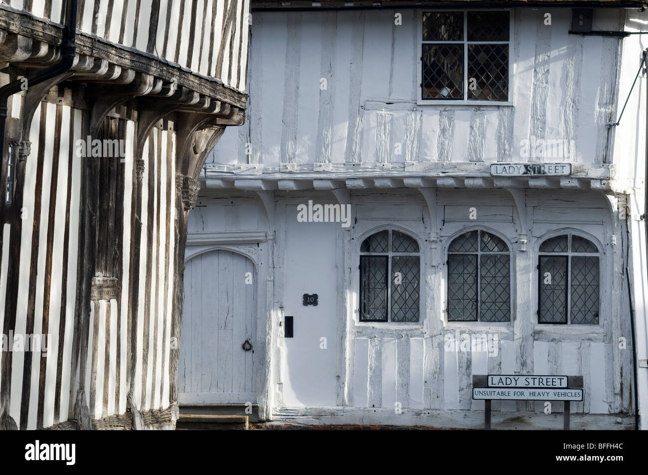 White-painted timber-framed wattled walls in Lavenham, Suffolk, England. - Stock Image