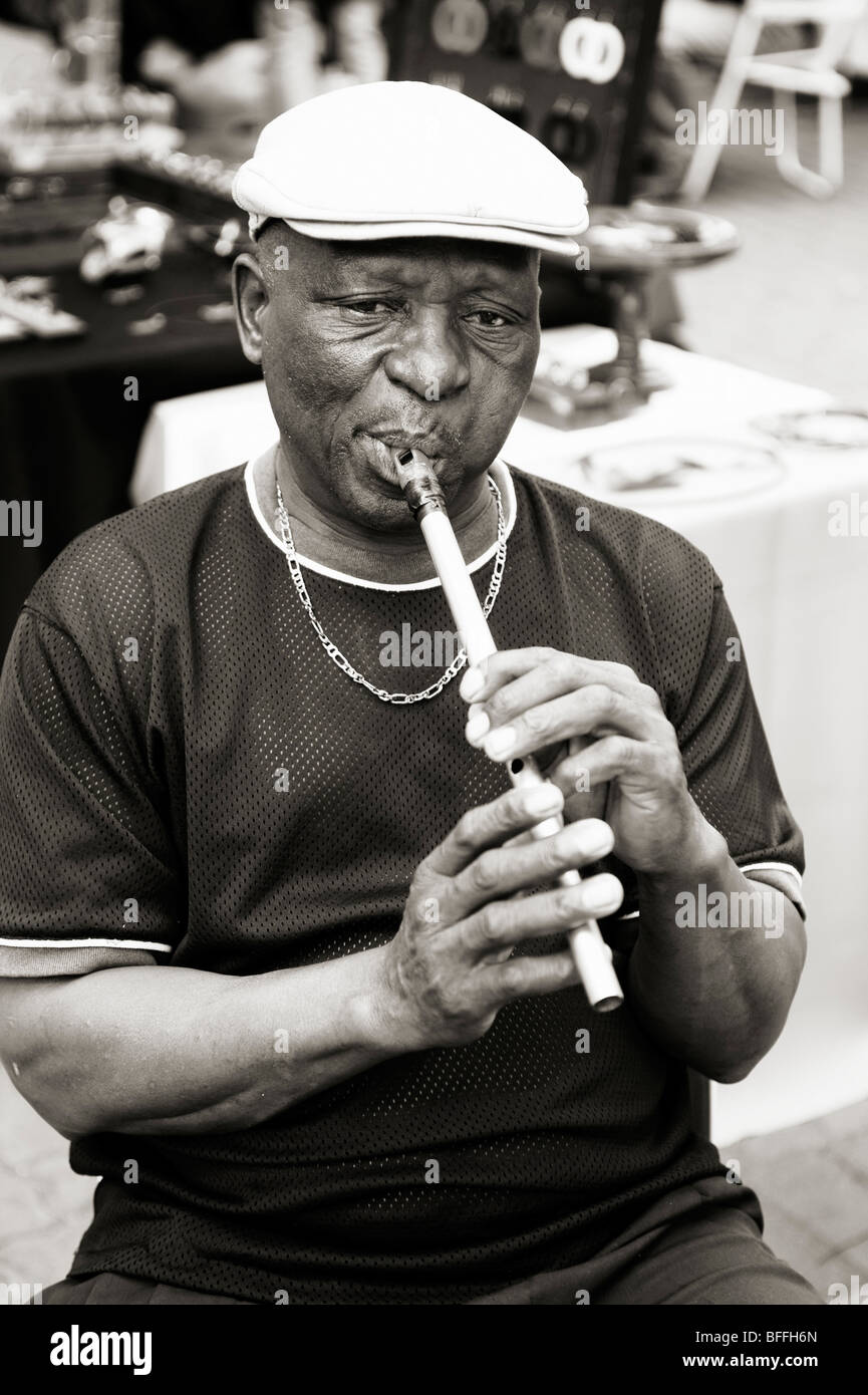 Man playing an African flute, or penny whistle. Ellis Park Street Market. Durban, South Africa - Stock Image