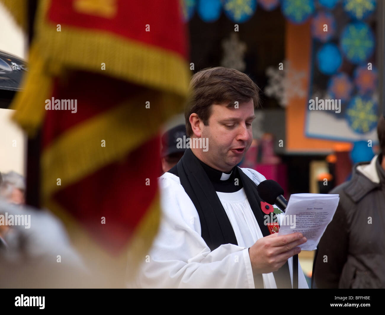 Church of England Vicar leading the singing of  'Jerusalem' at the Armistice Day service in Redcar Cleveland - Stock Image